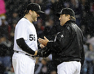 CHICAGO - SEPTEMBER 27:  Mark Buehrle #56 is removed from the game by manager Don Cooper #21 of the Chicago White Sox during the eighth inning against the Toronto Blue Jays on September 27, 2011 at U.S. Cellular Field in Chicago, Illinois.  Buehrle's appearance could be his last in a White Sox uniform. The White Sox defeated the Blue Jays 2-1.  (Photo by Ron Vesely)   Subject: Mark Buehrle;Don Cooper..
