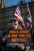 As Prime Minister Theresa May tours European capitals hoping to persuade foreign leaders to accept a new Brexit deal following her cancellation of a Parliamentary vote, Brexiteers taunt Remainers during protests by both sides opposite the Houses of Parliament, on 11th December 2018, in London, England.