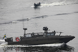 Saab demonstrates a CB90 Next Generation (CB90 NG) fast assault craft at Royal Victoria Dock on the first day of the DSEI 2021 arms fair at ExCeL London on 14th September 2021 in London, United Kingdom. Activists from a range of different groups have been protesting outside the venue for one of the world's largest arms fairs for over a week.