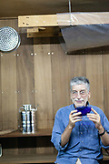Claudio Corallo, a world famous chocolate maker who sources the finest cacao on the island, drinks coffee in his laboratory in Sao Tome, Sao Tome and Principe<br /> Sao Tome and Principe, are two islands of volcanic origin lying off the coast of Africa. Settled by Portuguese convicts in the late 1400s and a centre for slaving, their independence movement culminated in a peaceful transition to self government from Portugal in 1975.