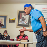 """Traditional practitioner Kenneth A. Joe tells a traditional Diné story to guests at the Behavioral Health Department in Crownpoint Wednesday.  """"Our language is inside us,"""" Joe said. """"It is a part of us."""""""