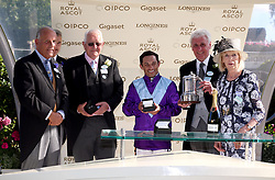 Owner Jeffrey Smith, Trainer David Elsworth and jockey Silvestre De Sousa are presented with their trophies after winning the Duke of Edinburgh Stakes with Dash of Spice during day four of Royal Ascot at Ascot Racecourse
