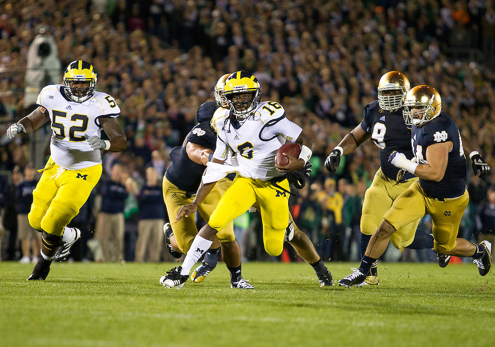 September 22, 2012:  Michigan quarterback Denard Robinson (16) runs for yardage during NCAA Football game action between the Notre Dame Fighting Irish and the Michigan Wolverines at Notre Dame Stadium in South Bend, Indiana.  Notre Dame defeated Michigan 13-6.