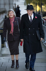 © Licensed to London News Pictures. 12/11/2017. London, UK. Liberal Democrat party Leader Vince Cable walks through Downing Street with his wide Rachel Smith to attend the Remembrance Sunday Ceremony at the Cenotaph in Whitehall. Photo credit: Peter Macdiarmid/LNP