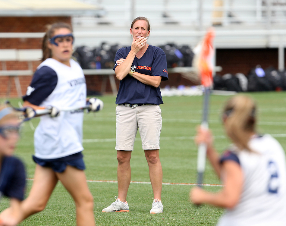 The University of Virginia women's lacrosse head coach Julie Meyers watchs her team practice before their first game since the tragic death of teammate Yeardley Love Sunday May 16, 2010 at Klockner Stadium in Charlottesville, Va. The Cavaliers rallied in the last four minutes to beat Towson 14-12 and reach the quarter finals of the NCAA tournament. Love's body was found May 3, and Virginia men's lacrosse player George Huguely is charged with murder. Photo/Andrew Shurtleff..