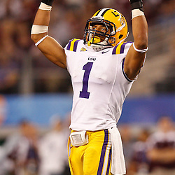 Jan 7, 2011; Arlington, TX, USA; LSU Tigers cornerback Eric Reid (1) pumps up the crowd during the second half of the 2011 Cotton Bowl against the Texas A&M Aggies at Cowboys Stadium.  Mandatory Credit: Derick E. Hingle