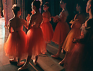 """Giving the """"o.k."""" sign, Jessica Anderson, left, reflects the group's eagerness to perform their roles as """"Sugar Plum Flowers"""" in the Sacramento Ballet's rendition of The Nutcracker December 10, 1998. The other dancers, left to right: Anderson, Erica Motley, Judith Hester, Julie Anne Miller, Rebecca Harris, and Megan Rumery."""