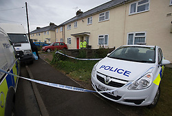 © licensed to London News Pictures. Braintree, UK  06/06/2011. Police and forensics outside a property (white door) on Bartram Avenue in Braintree, Essex today (06/06/2011) where the bodies of a woman and a child were found following a shooting. Officers were called to reports of a firearms incident in the early hours of the morning. Photo credit should read Ben Cawthra/LNP