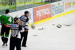 Newspapers on the ice during ice-hockey match between HDD Tilia Olimpija Ljubljana (SLO) and EC Red Bull Salzburg (AUT) in 2nd Quaterfinals of EBEL league, on March 1, 2011 in Hala Tivoli, Ljubljana, Slovenia. (Photo By Vid Ponikvar / Sportida.com)