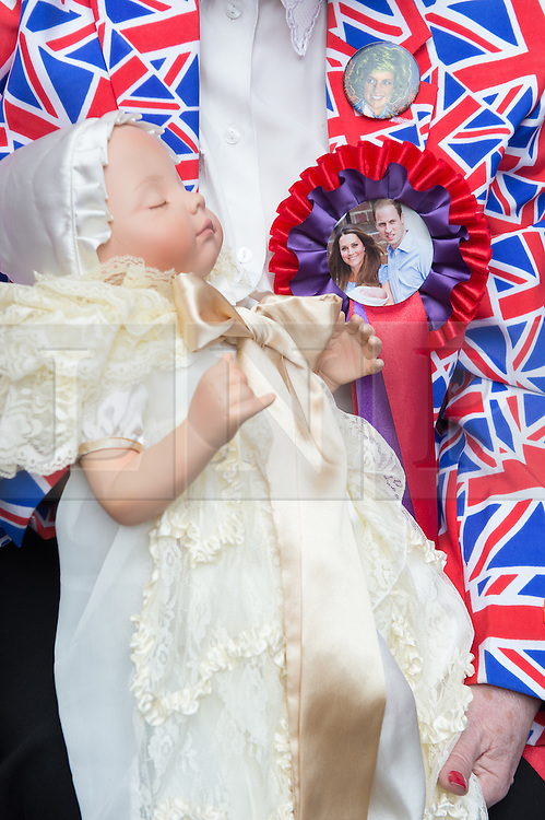 © London News Pictures. 03/04/15. London, UK. Maragaret Tyler holds a baby doll as she waits outside the Lido Wing for the birth of the second child of the Duke and Duchess of Cambridge, St Mary's Hospital, Central London. Photo credit: Laura Lean/LNP