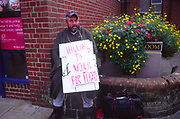 AMFY05 Man with sign saying willing to work for food