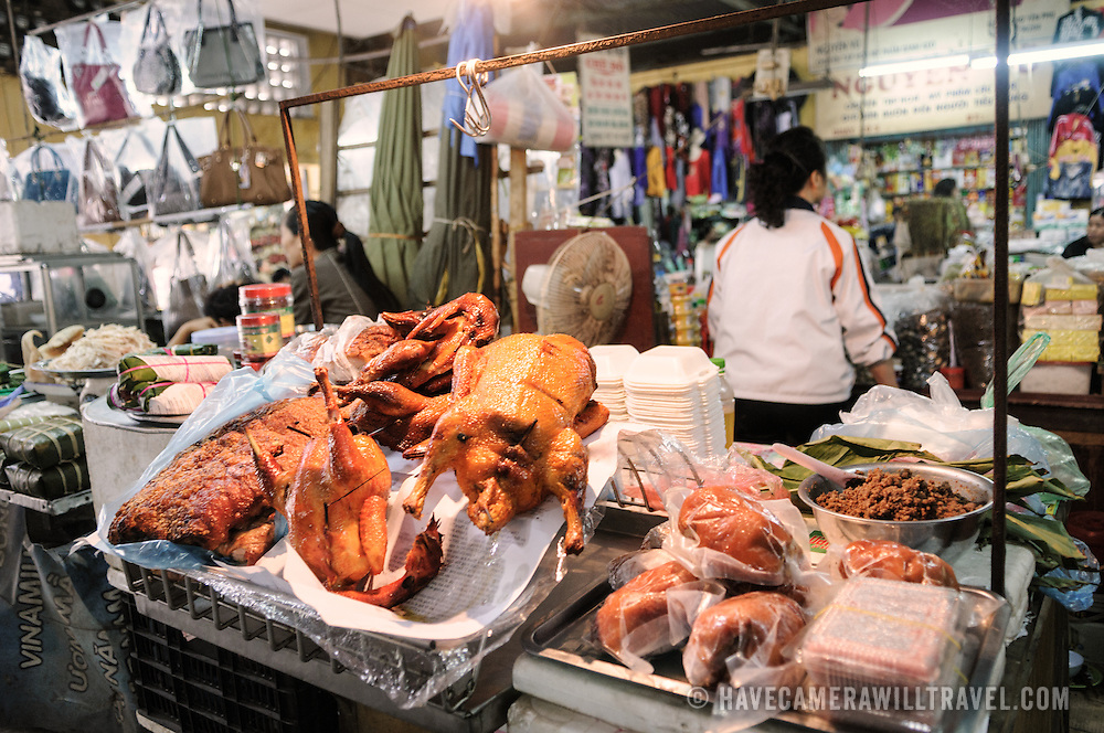 Various cooked meats for sale at a morning market in Hanoi, Vietnam.