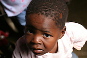 Mxolisi, 2, a HIV positive child living in Langa township, Cape Town, is portrayed in his home.