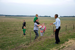 President Barack Obama greets a family after his visit to Stonehenge in Wiltshire, England, Sept. 5, 2014. (Official White House Photo by Pete Souza)<br /> <br /> This official White House photograph is being made available only for publication by news organizations and/or for personal use printing by the subject(s) of the photograph. The photograph may not be manipulated in any way and may not be used in commercial or political materials, advertisements, emails, products, promotions that in any way suggests approval or endorsement of the President, the First Family, or the White House.