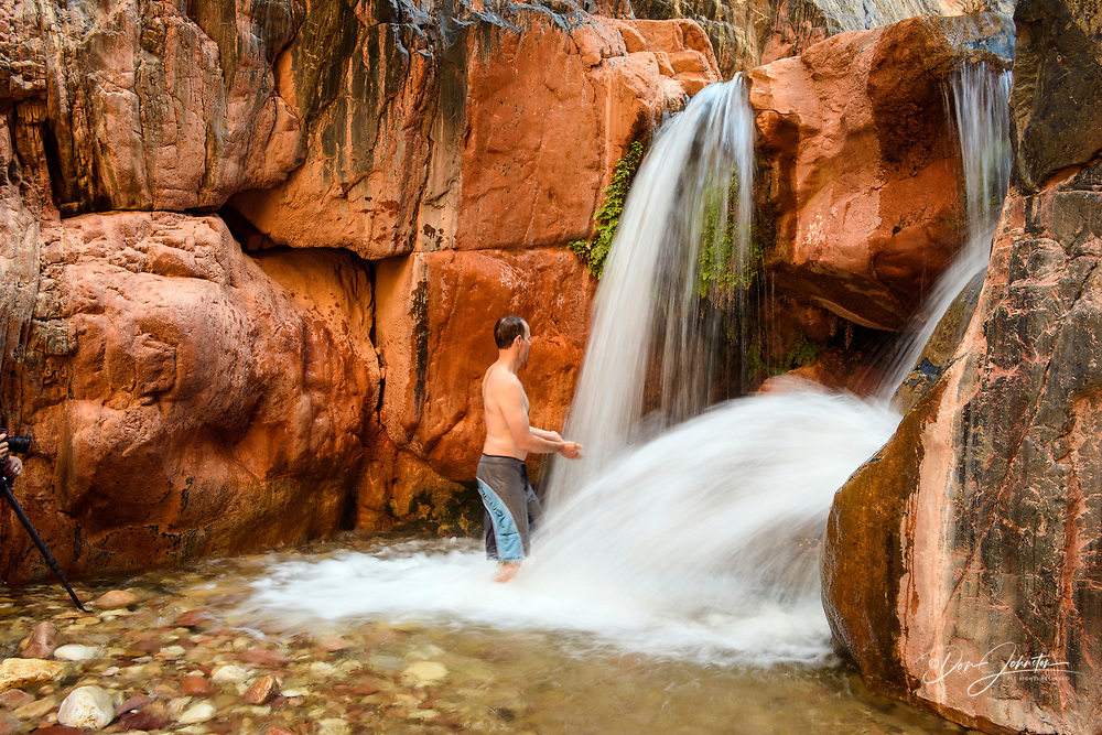 Day hikers refreshing themselves in Clear Creek canyon waterfall, Grand Canyon National Park, Arizona, USA