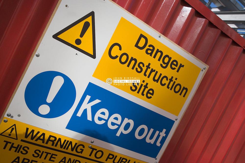 Danger warning sign outside a building construction site,