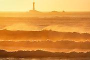 Longships Lighthouse & huge surf off Land's End, Cornwall