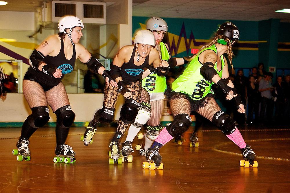 Feb. 26, 2007; Virginia Beach, VA, USA; Buffalo Bone Crusher (center) fights her way pass the blockers of Harrisburg Area Roller Derby. Mandatory Credit: Peter J. Casey