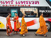 05 DECEMBER 2016 - BANGKOK, THAILAND:  Buddhist monks walk back to their buses after a ceremony honoring His Majesty on Bhumibol Bridge. Tens of thousands of Thais gathered on Bhumibol Bridge in Bangkok Monday to mourn the death of Bhumibol Adulyadej, the Late King of Thailand. The King died on Oct 13 after a lengthy hospitalization. December 5 is his birthday and a national holiday in Thailand. The bridge is named after the late King, who authorized its construction. 999 Buddhist monks participated in a special merit making ceremony on the bridge.      PHOTO BY JACK KURTZ