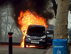 © London News Pictures. 17/03/2012. London, UK. A car which caught fire when a double-decker bus exploded into flames on Pepys Road in Brockley, South East London on March 17th, 2012. Everyone on the bus escaped the incident unharmed, despite the fire also causing two cars parked nearby to burst into flames. Photo credit : Jason Cuddy/LNP.