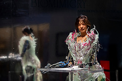© Licensed to London News Pictures. 17/09/2021. LONDON, UK. Paula Sello and Alissa Aulbekova's fashion house Auroboros showcase a real-time growing couture gown worn by Ai-Da, the world's first artist robot, that will grow and fall apart during the festival whilst Ai-Da draws a self-portrait that can be experienced virtually. Launch of this year's London Design Festival at the V&A Museum in South Kensington.  Installations, projects, performances and events explore design thinking in the challenge of climate change. Photo credit: Stephen Chung/LNP