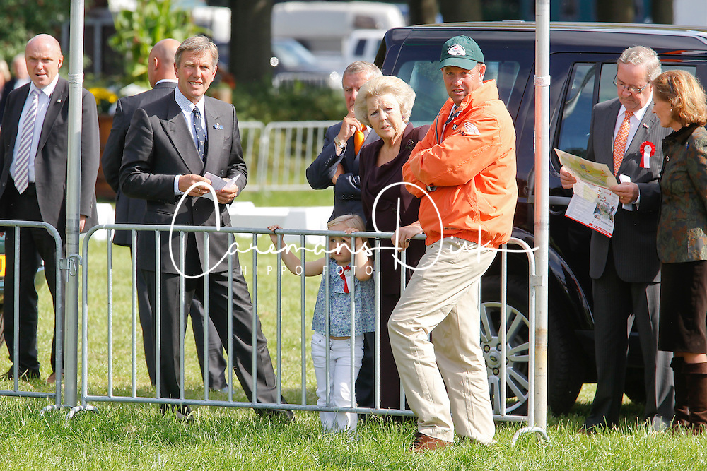 Queen Beatrix visiting Breda Hippique with Princesses Amalia and Ariana watching competion with World Champion four in hand, IJsbrandt Chardon (NED)<br /> Breda Hippique 2010<br /> © Dirk Caremans