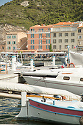 Yachts in harbor and buildings on background, Bonifacio, Corsica, France