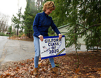Margie Cybart delivers signs to the homes of Gilford graduating seniors on Monday afternoon.  (Karen Bobotas/for the Laconia Daily Sun)