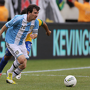Lionel Messi, Argentina, goes past Marcelo, Brazil, during the Brazil V Argentina International Football Friendly match at MetLife Stadium, East Rutherford, New Jersey, USA. 9th June 2012. Photo Tim Clayton