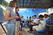 """EVANGELISM AMERICAN STYLE. South East Asia. Battambang, Cambodia. A 'University of Nations' project, registered in Cambodia as a project of the international Christian Evangelical 'Youth With a Mission' (YWAM), run by 'Group Leader' Garth Gustafson. It is a fanatical Evangelist youth movement who use english and sports teachings as a vehicle, together with religious indocrination, to turn buddhist youth and even monks, towards the Christian Bible. Garth preaches quasi-religeous sermons about 'hot and cold' climate types, of Western moral superiority and stronger work ethics, American right obsessions with family and personal responsibility, versus """"primitive people who use smiles to hide their lies"""". They preach they """"want to see your (Cambodian) nation change to be a good nation, to glorify God"""" but YWAM is a cult-like organisation with right wing and facism roots. The YWAMers force themselves upon AIDS patients in local hospitals, looking for the very sick and dying, offering neither drugs nor food, but instead, prayers about Christian redemption, offer everlasting life, which when rejected by buddhists, they are accused of being """"bitter"""" for declining them.///'Youth With a Mission' (YWAM), english and religious classes, teachers and volunteers indoctrinate Khmer youths"""
