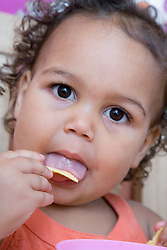 Toddler eating a snack,