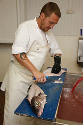 Man filleting haddock