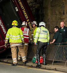 A articulated lorry tipped over under the bridge approaching the Old Dalkeith Road near the Cameron Toll shopping centre Edinburgh this morning. The emergency services were on hand very quickly and were working on how best to resue the driver. He appeared to be uninjured but trapped due to the angle  the vechicle ended up in. 18 June 2014 (c) GER HARLEY   StockPix.eu