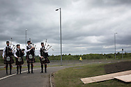 Four pipers pictured at the official unveiling of Steel Man, a new sculpture by Scottish artist Andy Scott, made to commemorate those who lost their lives in the iron and steel industry in Scotland. The memorial was sited at Ravenscraig in Lanarkshire, on the site of Europe's largest former hot strip mill, which closed in 1992. The site was cleared in 1996 and now houses a sports centre, college and housing.