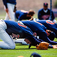 Minnesota Twins players stretch and warm up before spring training practice.