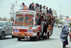 July 5, 2018 - Pakistan - QUETTA, PAKISTAN, JUL 04: Passengers traveling on an overloaded bus violating traffic .rules, showing negligence of authority, at Joint road in Quetta on Wednesday, July 04, 2018. (Credit Image: © PPI via ZUMA Wire)