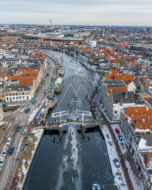 Aerial view of Haarlem during winter with ice skating people on canals, Haarlem, Noord-Holland, Netherlands.