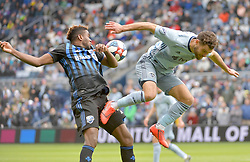 Mar 30, 2019; Kansas City, KS, USA; Sporting Kansas City midfielder Graham Zusi (8) and Montreal Impact forward Orji Okwonkwo (18) fight for the ball during the first half at Children's Mercy Park. Mandatory Credit: Denny Medley-USA TODAY Sports