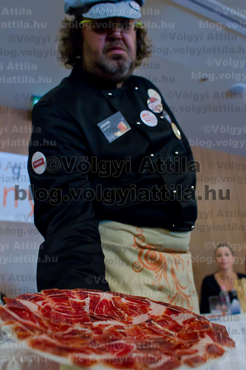 Competitor shows his work after judging during the first ever ham slicing competition in Budapest, Hungary on May 9, 2012. ATTILA VOLGYI