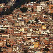 The favela Vila Canoa and favela Vila Pedra Bonita on the hlllside overlooking Leblon and Ipanema beaches, Rio de Janeiro,  Brazil. 12th July 2010. Photo Tim Clayton..