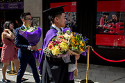 Immediately after their graduation ceremonies, new graduates meet relatives and family outside the London School of Economics (LSE), on 22nd July 2019, in London, England.