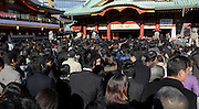 business people celebrating the start of the year on their first day of work at the Asakusa Kannon Temple Tokyo