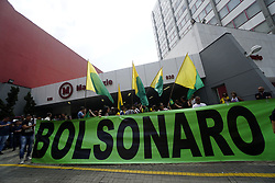 March 27, 2019 - Sao Paulo, Brazil - Supporters of Brazil's President Jair Bolsonaro and critics of President Jair Bolsonaro yell at each other in front of the Mackenzie University entrance on the street Consolacao and Maria Antonia in downtown Sao Paulo, Brazil on Mar. 27, 2019. Bolsonaro;s appearance at the University was cancelled. (Credit Image: © Cris Faga/NurPhoto via ZUMA Press)