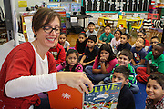 Houston ISD trustee Anna Eastman reads to students at Jefferson Elementary School, December 16, 2015.