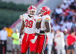 Sep 4, 2021; College Park, Maryland, USA; Maryland Terrapins linebacker Deshawn Holt (39) celebrates with Maryland Terrapins linebacker Gereme Spraggins (21) after a sack on West Virginia Mountaineers quarterback Jarret Doege (2) during the first quarter at Capital One Field at Maryland Stadium. Mandatory Credit: Ben Queen-USA TODAY Sports