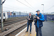 Two male trainspotters on the platform at Hornsey train station on 27th March 2018 in North London, United Kingdom.