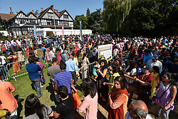 © Licensed to London News Pictures. 02/09/2018. WATFORD, UK.  Thousands of devotees queue up outside the manor house temple to attend darshan (prayers) at the biggest Janmashtami festival outside of India at the Bhaktivedanta Manor Hare Krishna Temple in Watford, Hertfordshire.  The event, which celebrates the birth of Lord Krishna, includes a cultural and spiritual festival at a property donated to the Hare Krishna movement by ex Beatle George Harrison.  Photo credit: Stephen Chung/LNP