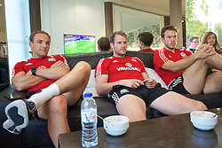 VALE DO LOBO, PORTUGAL - Saturday, May 28, 2016: Wales' David Vaughan, goalkeeper Owain Fon Williams and goalkeeper Chris Maxwell watch the UEFA Champions League Final, featuring their team-mate Gareth Bale, during day five of the pre-UEFA Euro 2016 training camp at the Vale Do Lobo resort in Portugal. (Pic by David Rawcliffe/Propaganda)