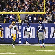 Jason Pierre-Paul, New York Giants, heads for the end zone after picking off Packers Quarterback Scott Tolzien  during the New York Giants Vs Green Bay Packers, NFL American Football match at MetLife Stadium, East Rutherford, New Jersey, USA. 17th November 2013. Photo Tim Clayton