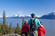 Family enjoying a hike together at HcHugh Creek Recreation Area in the Chugach National Forest. Trails offer a great view over Turnagain Arm and the Chugach mountains.